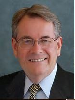 Photo of Florida State Senator Don Gaetz sporting a dark suit and a white shirt and tie.